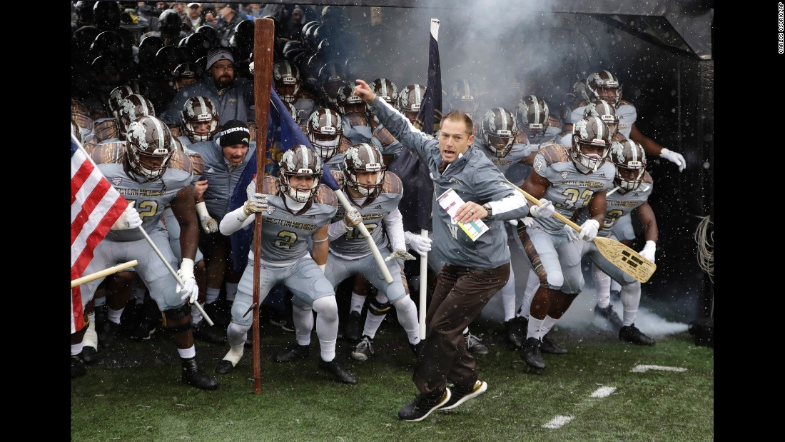 Western Michigan head coach P.J. Fleck leads his team onto the field before their home game against Buffalo on Saturday, November 19. The Broncos won 38-0 to improve their record to 11-0. Alabama is the only other undefeated team in college football's top division.