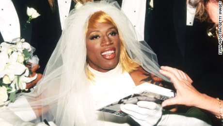 "278566 01: Dennis Rodman signs his autobiography August 21, 1996 in New York City. Rodman arrived in a horse-drawn carriage dressed in a wedding gown to launch his new book called ""Bad as I Wanna Be."" (Photo by Evan Agostini/Liaison)"