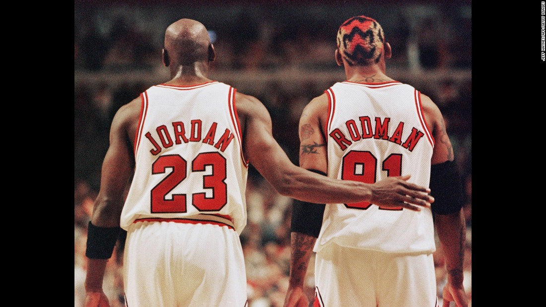 Rodman and teammate Michael Jordan were an unlikely duo in Chicago. Rodman, the tattooed, controversial free spirit, seemed nothing like Jordan, the clean-cut, corporate-friendly mega-star. But the Bulls won three straight titles and set a record for most regular-season wins in 1996.
