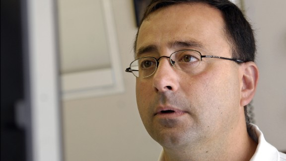 FILE - In this July 15, 2008, file photo, Dr. Larry Nassar works on the computer after seeing a patient in Michigan. Nassar, a former USA Gymnastics team doctor, was charged Monday, Nov. 21, 2016, with first-degree criminal sexual conduct in Michigan involving a child under 13. (Becky Shink/Lansing State Journal via AP, File)