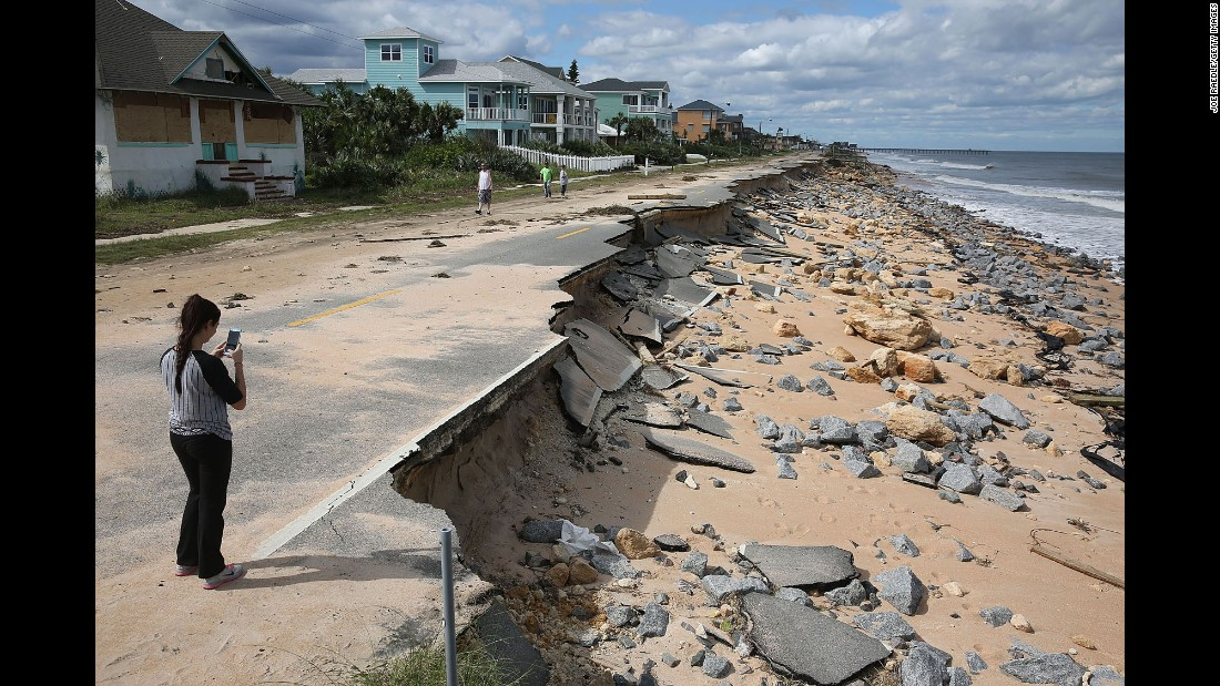Ocean waters stirred up by Hurricane Matthew washed away part of this road in Flagler Beach, Florida, on Saturday, October 8.