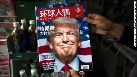"TOPSHOT - A copy of the local Chinese magazine Global People with a cover story that translates to ""Why did Trump win"" is seen with a front cover portrait of US president-elect Donald Trump at a news stand in Shanghai on November 14, 2016.   Chinese President Xi Jinping and US president-elect Donald Trump agreed November 14 to meet ""at an early date"" to discuss the relationship between their two powers, Chinese state broadcaster CCTV said.  / AFP / JOHANNES EISELE        (Photo credit should read JOHANNES EISELE/AFP/Getty Images)"