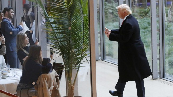President-elect Donald Trump gestures to people seated in a restaurant as he leaves the New York Times building following a meeting, Tuesday, Nov. 22, 2016, in New York. (AP Photo/Mark Lennihan)