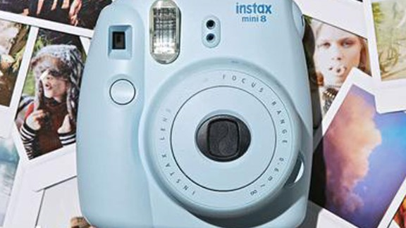 """For the friend that loves to snap away, check out this Fujifilm Instax Mini 8 Camera. It's a celeb favorite and it starts at $99.<a href=""""https://www.shopmixology.com/products/fujifilm-1fujins8m-instax-mini-8-camera-blue"""" target=""""_blank"""" target=""""_blank""""> Click here to check out all the colors it comes in. </a>"""