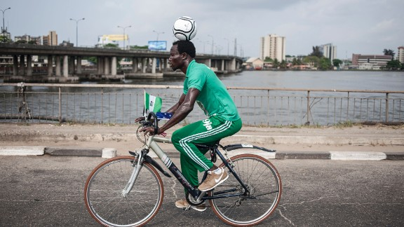 Harrison Chinedu cycling through the streets of Lagos on November 20, 2016 during his World Cup attempt.