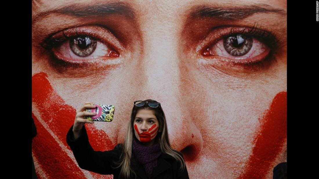 "An activist in Sao Paulo, Brazil, takes a selfie Friday, June 10, during a protest against rape and violence against women. The protest came weeks after <a href=""http://www.cnn.com/2016/05/30/americas/brazil-gang-rape-victim-speaks/"" target=""_blank"">a 16-year-old girl was reportedly gang-raped</a> in Rio de Janeiro."