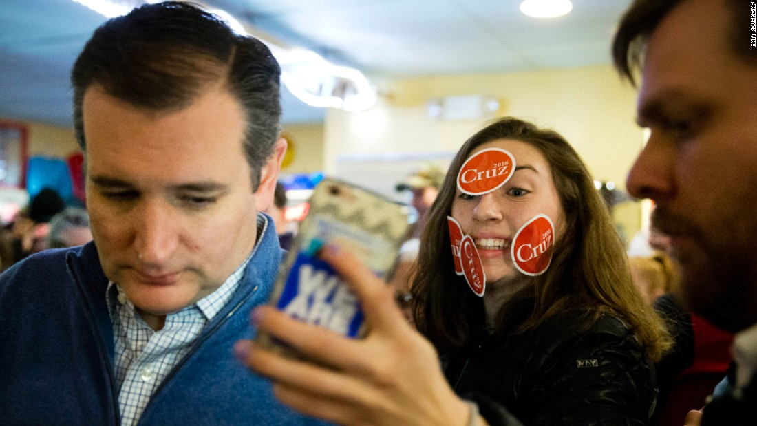 A young woman tries to get a selfie with US Sen. Ted Cruz during the presidential candidate's campaign stop in Tilton, New Hampshire, on Monday, January 18.