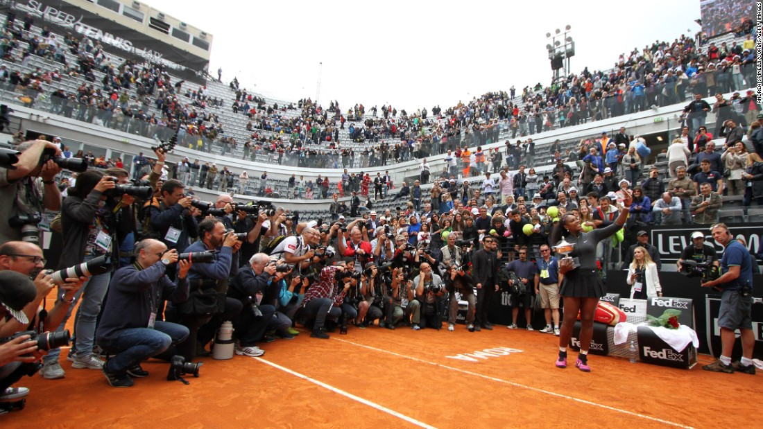 Tennis star Serena Williams takes a photo with her trophy after winning the Italian Open in Rome on Sunday, May 15.