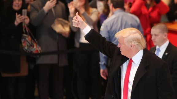 NEW YORK, NY - NOVEMBER 22:  President-elect Donald Trump gives a thumbs up to the crowd as he walks through the lobby of the New York Times following a meeting with editors at the paper on November 22, 2016 in New York City. Trump, who has held meetings with media executives over the last few days, has often had a tense relationship with many mainstream media outlets.  (Photo by Spencer Platt/Getty Images)