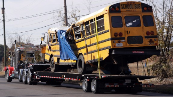A school bus is carried away Tuesday, November 22, in Chattanooga, Tennessee from the site where it crashed on Monday. The bus driver, Johnthony Walker, has been arrested on charges including vehicular homicide, reckless driving and reckless endangerment.