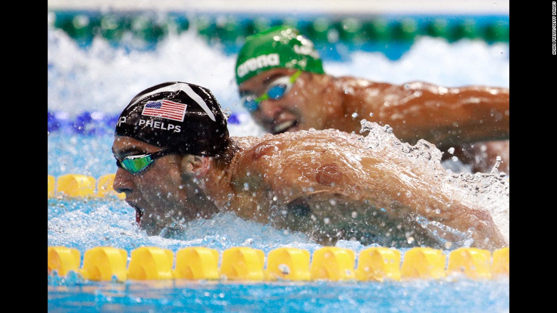 "South African swimmer Chad Le Clos glances at US swimmer Michael Phelps during the Olympic final of the 200-meter butterfly on Tuesday, August 9. Phelps, the most decorated Olympian of all time, <a href=""http://www.cnn.com/2016/08/13/sport/michael-phelps-legacy-rio-2016-olympics/"" target=""_blank"">won the race</a> for his 20th career gold medal. He avenged one of the few losses of his Olympic career -- a second-place finish to Le Clos in 2012. Le Clos finished fourth."