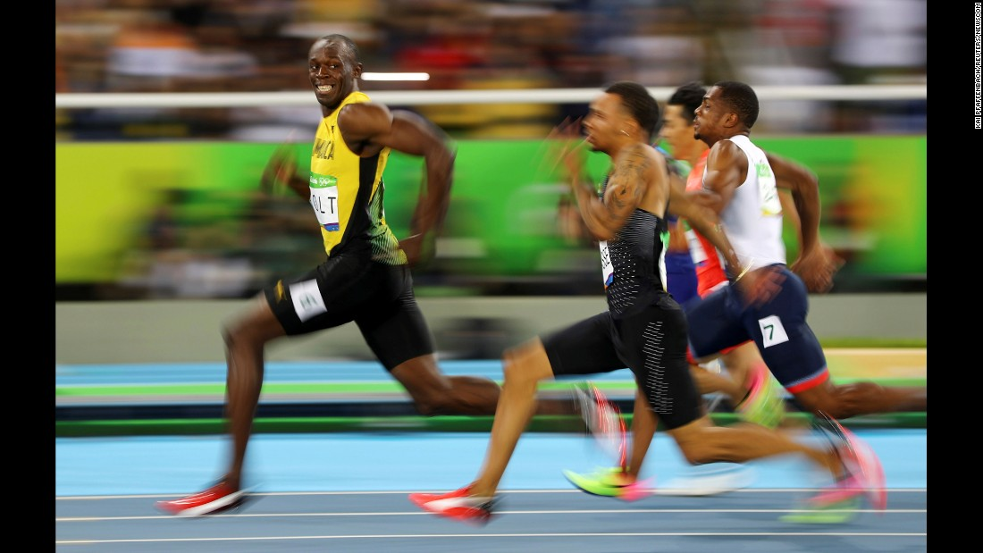 "Jamaican sprinter Usain Bolt looks back at his Olympic competitors during a 100-meter semifinal on Sunday, August 14. Bolt <a href=""http://www.cnn.com/2016/08/14/sport/usain-bolt-justin-gatlin-olympic-games-100-meters-rio/"" target=""_blank"">won the final</a> a short time later, becoming the first man in history to win the 100 meters at three straight Olympic Games."