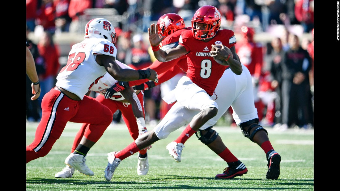 Louisville quarterback Lamar Jackson strikes a Heisman-esque pose during a home game against North Carolina State on Saturday, October 22. Many consider Jackson to be the Heisman Trophy front-runner this season.