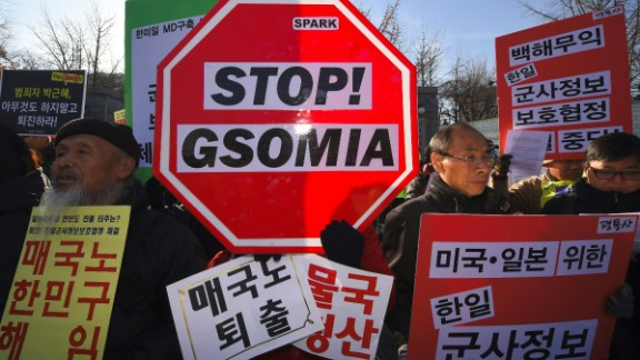 South Korean protesters hold a rally Wednesday in Seoul against the signing of a military agreement with Japan.