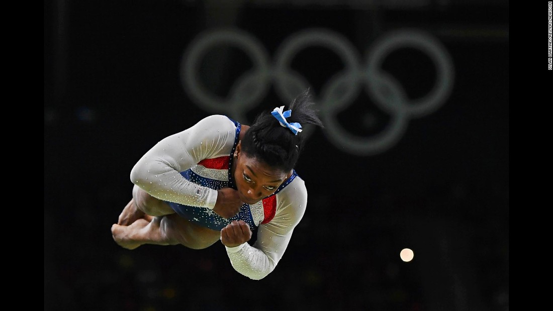 "US gymnast Simone Biles competes on the vault after <a href=""http://www.cnn.com/2016/08/11/sport/simone-biles-usa-gymnastics-rio/index.html"" target=""_blank"">winning Olympic gold in the individual all-around</a> on Thursday, August 11. Biles also won team gold earlier in the week."