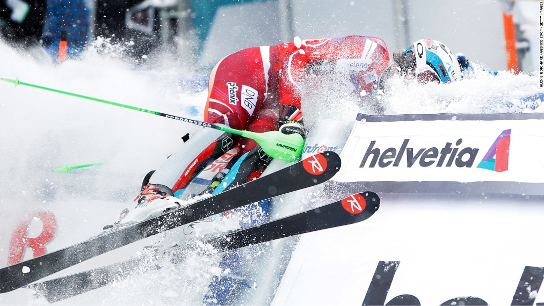 Norwegian skier Henrik Kristoffersen crashes in the arrival area after winning the World Cup slalom race in Wengen, Switzerland, on Sunday, January 17.