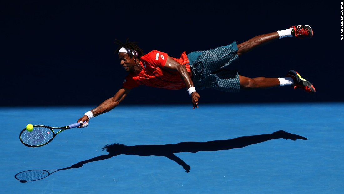 Gael Monfils dives for a forehand during his fourth-round match at the Australian Open on Monday, January 25.