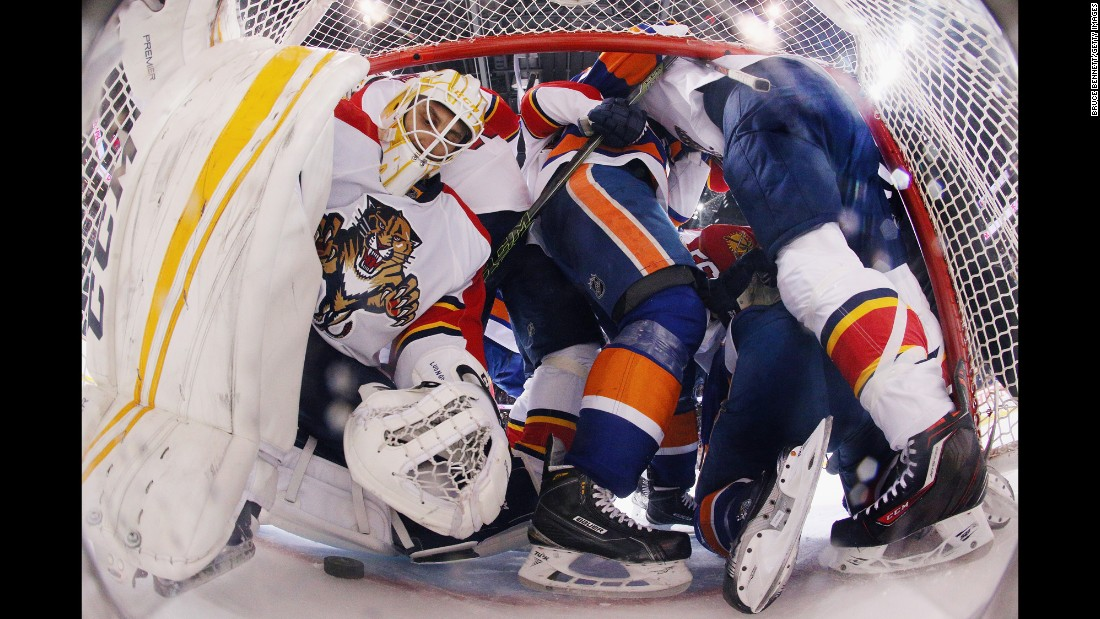Players crowd the crease of Florida goalie Roberto Luongo during an NHL playoff game in New York on Wednesday, April 20.