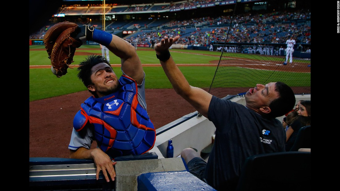 New York Mets catcher Travis d'Arnaud snags a foul ball in Atlanta on Friday, April 22.