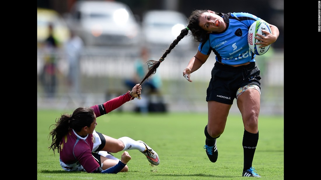 Venezuela's Maryoly Gomez pulls the hair of Uruguay's Victoria Rios during a rugby sevens match in Rio de Janeiro on Sunday, March 6.