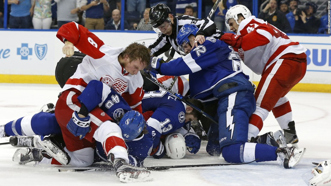 Players from Detroit and Tampa Bay fight during an NHL playoff game on Friday, April 15.