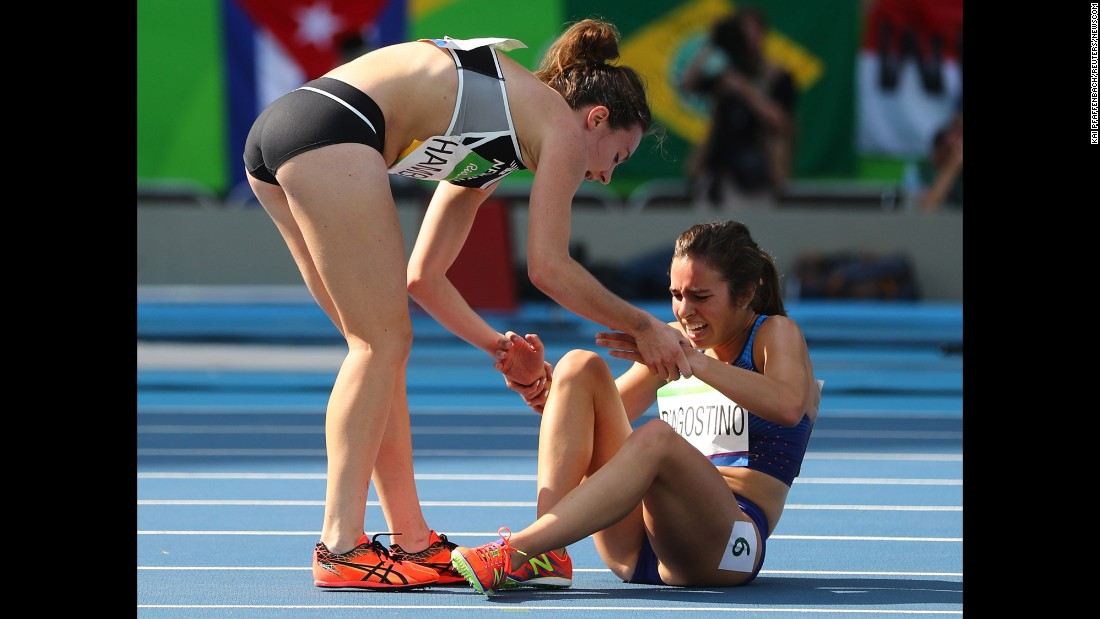 "New Zealand's Nikki Hamblin, left, helps Abbey D'Agostino of the United States after they collided during the Olympics' 5,000-meter semifinal on Tuesday, August 16. Both runners managed to finish the race, and fans applauded <a href=""http://www.nbcolympics.com/video/us-runner-finishes-race-after-falling-hard"" target=""_blank"">their outstanding display of sportsmanship.</a>"