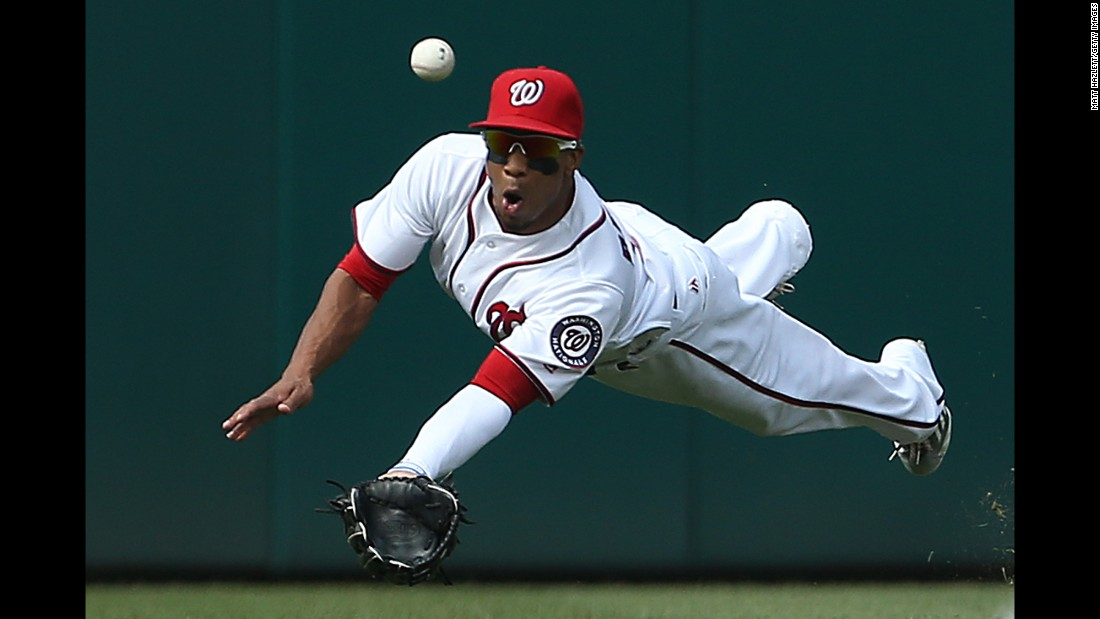 Washington outfielder Ben Revere tries to make a diving catch during a Major League Baseball game on Wednesday, June 15.