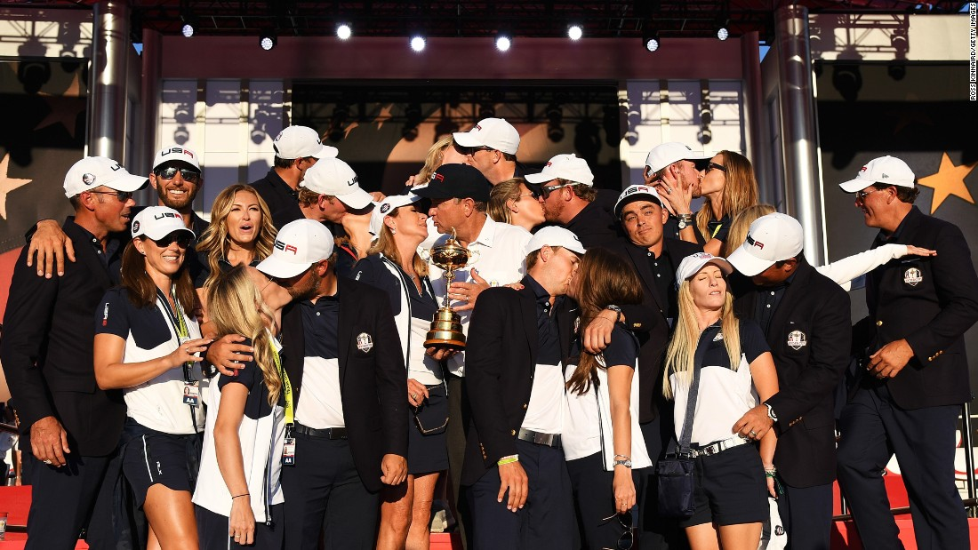 "Golfer Rickie Fowler shrugs as his US teammates kiss their wives and girlfriends <a href=""http://www.cnn.com/2016/10/03/golf/ryder-cup-2016-reactions-obama-arnold-palmer/index.html"" target=""_blank"">during a team photo</a> on Sunday, October 2. The Americans had just won <a href=""http://www.cnn.com/2016/10/02/golf/golf-ryder-cup-usa-europe/index.html"" target=""_blank"">their first Ryder Cup since 2008.</a>"