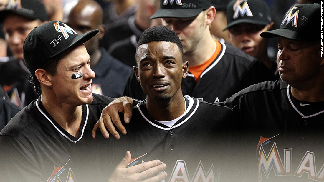 "Miami Marlins second baseman Dee Gordon is consoled by teammates after hitting a leadoff home run against the New York Mets on Monday, September 26. Gordon and the rest of the Marlins were mourning teammate Jose Fernandez, <a href=""http://www.cnn.com/2016/09/25/us/mlb-pitcher-jose-fernandez-dead/"" target=""_blank"">who died in a boating accident</a> the day before at the age of 24."