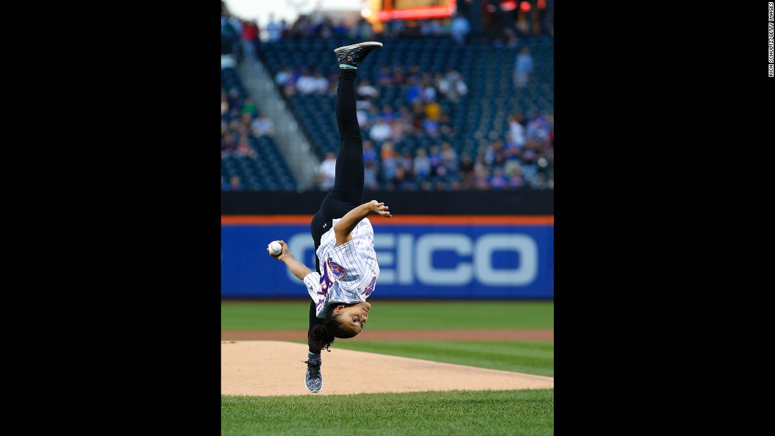 Olympic gold-medal gymnast Laurie Hernandez flips as she throws the first pitch before a New York Mets game on Saturday, September 3.