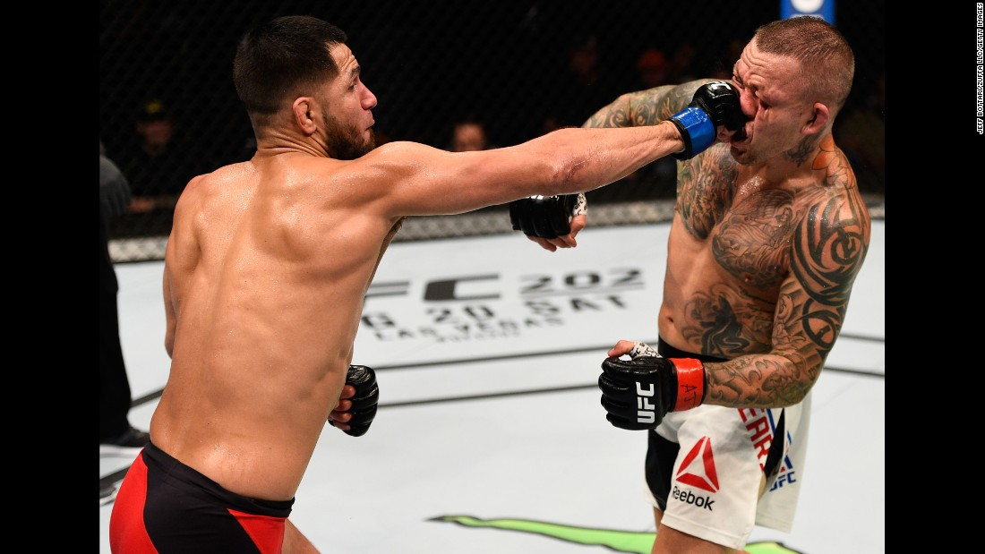 Jorge Masvidal punches Ross Pearson during their UFC bout in Atlanta on Saturday, July 30. Masvidal won by unanimous decision.
