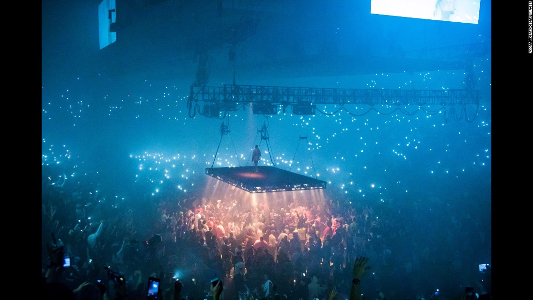 "Rapper Kanye West performs in Detroit during his Saint Pablo Tour on Wednesday, September 28. West <a href=""http://www.cnn.com/2016/11/21/entertainment/kanye-west-hospitalized/index.html"" target=""_blank"">was hospitalized in late November</a> shortly after canceling the rest of his tour. A source close to West's family told CNN that he was being treated for exhaustion."