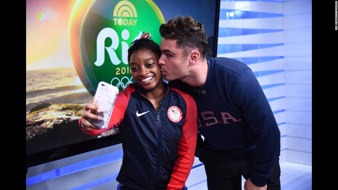 "Actor Zac Efron kisses gymnast Simone Biles, this year's Olympic champion, during a surprise visit to the Olympic Village in Rio de Janeiro on Tuesday, August 16. ""Another Olympic dream came true today in Rio!"" <a href=""https://twitter.com/USAGym/status/765661798527799298"" target=""_blank"">tweeted USA Gymnastics.</a> Biles' fans know the gymnast has a soft spot for Efron."