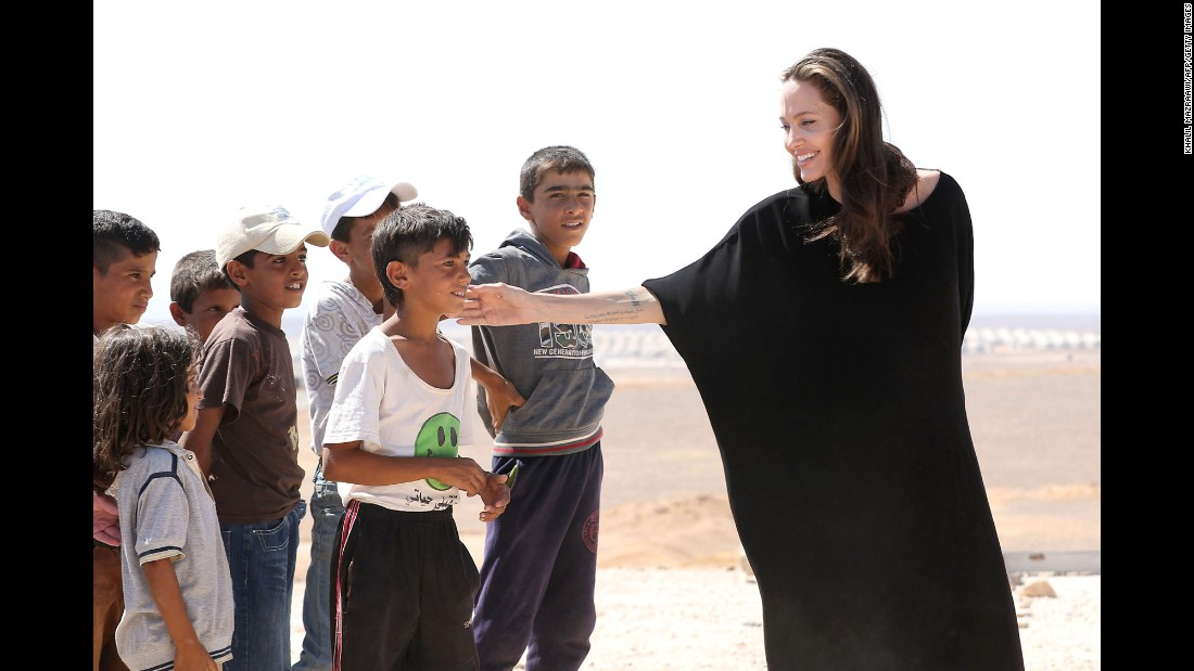 "Actress <a href=""http://www.cnn.com/2013/05/14/showbiz/gallery/angelina-jolie/index.html"" target=""_blank"">Angelina Jolie</a>, who is a special envoy for the United Nations' refugee agency, talks to Syrian children at a refugee camp in Azraq, Jordan, on Friday, September 9."