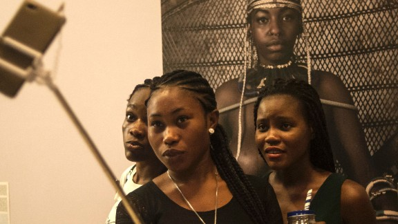 Smartphone sales now account for 23% of the mobile phone market. These sales are set to increase as infrastructure is modernized and network coverage improves.   Pictured: Visitors take selfies during the opening of the Lagos Photo festival in Lagos on October 22, 2016.
