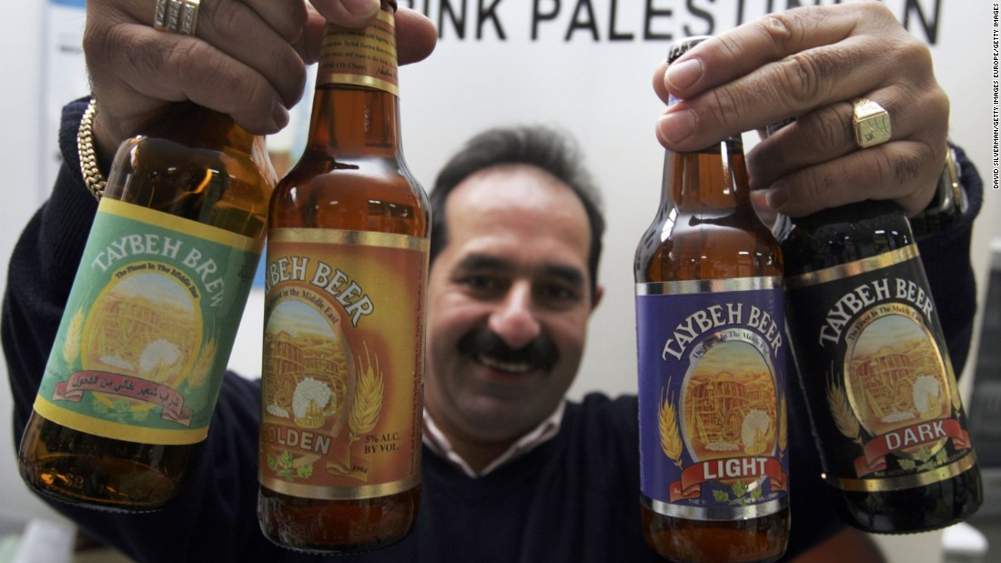 Nadim Khoury displays the products made at his brewery, named after his home village of Taybeh, in the West Bank.
