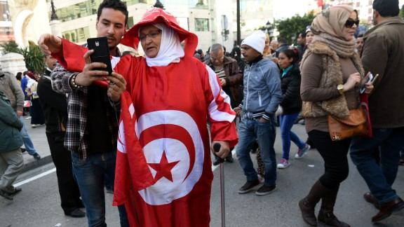 Half of the 4G networks currently in use are less than two years old and 4G has just been made available in 24 countries.  Pictured: A Tunisian man takes a selfie with a woman wrapped in cloth with a print of their national flag during a rally on January 14, 2016 in the Habib Bourguiba Avenue in the capital Tunis, to mark the fifth anniversary of the 2011 revolution.
