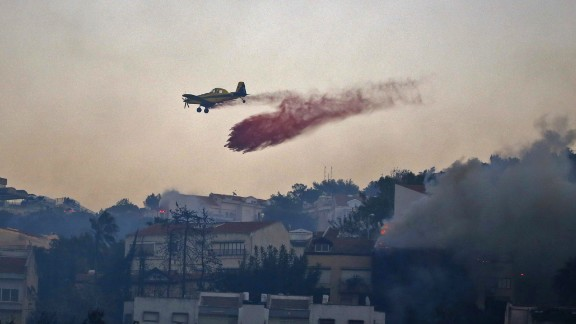 An Israeli firefighter plane helps extinguish a blaze in Haifa.