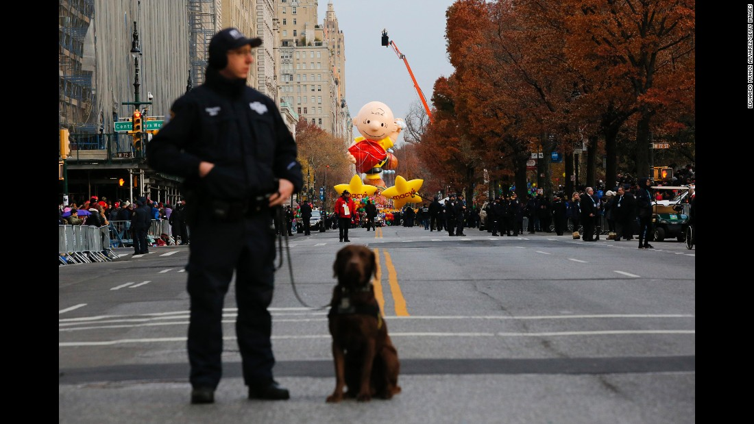 "A New York police officer stands guard with his dog during the annual <a href=""http://www.cnn.com/2016/11/24/us/gallery/macys-thanksgiving-parade-2016/index.html"" target=""_blank"">Macy's Thanksgiving Day Parade</a> on Thursday, November 24."