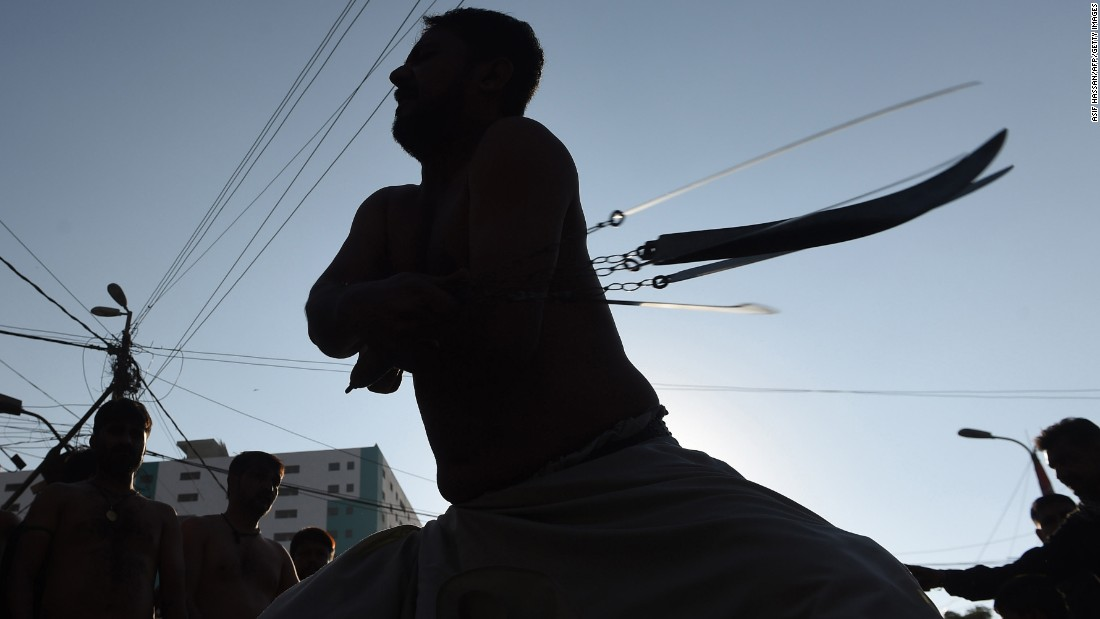 Shiite Muslims participate in ritual self-flagellation during a religious procession in Lahore, Pakistan, on Monday, November 21.