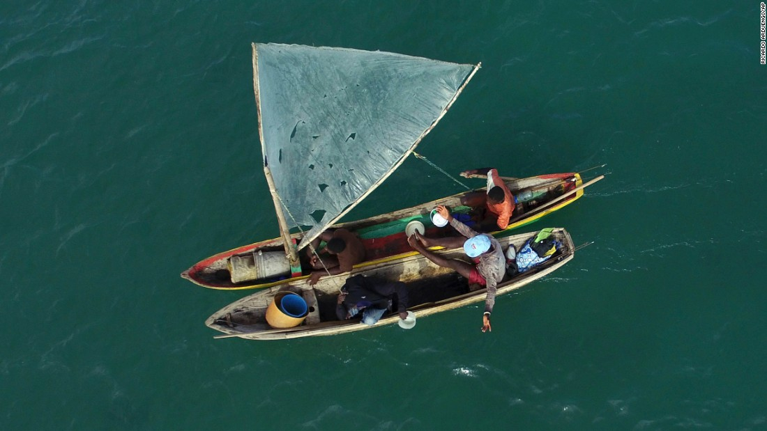 Fishermen sail a wooden boat in the bay of Port-au-Prince, Haiti, on Wednesday, November 23.