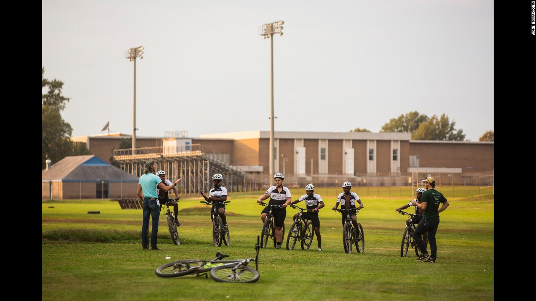Dodson and his colleague Matt Kuhn lead cycling practice behind Armstrong High School in Richmond, Va.
