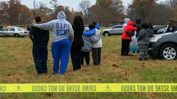 People comfort each other after a shooting at a park in Louisville Thursday.
