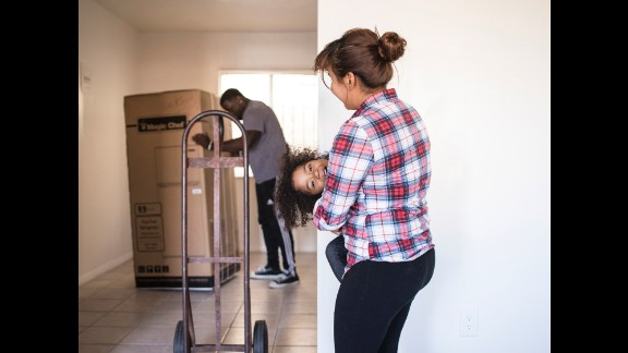 Smith's team unpacks and organizes housewares and furniture for Stephanie and her daughter Ja'el in their new apartment in Los Angeles.