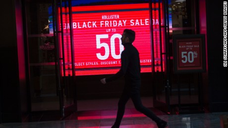A clothing shop promotes 'Black Friday' discounts at the Trafford Centre shopping mall in Manchester, north-west England, on November 25, 2016.  Black Friday is a sales offer originating from the US where retailers slash prices on the day after the Thanksgiving holiday. In the UK it is used as a marketing device to entice Christmas shoppers. / AFP / OLI SCARFF        (Photo credit should read OLI SCARFF/AFP/Getty Images)