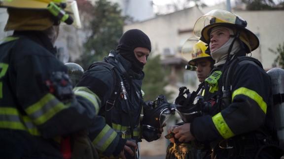 Israeli firefighters work in Haifa on November 25.