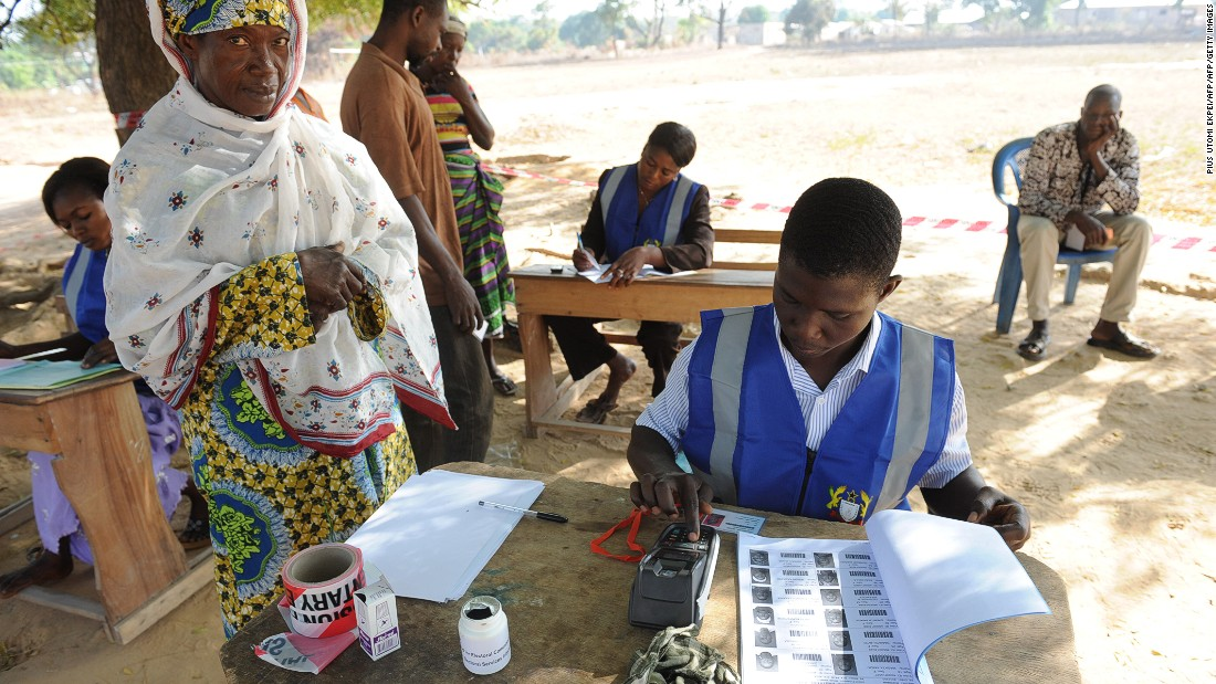 Eight in 10 Ghanaians believe the presence of armed security personnel at polling stations during the 2016 polls will make them feel more secure.<br /><br />Pictured: An electoral officer checks the identity of a voter at the Bole polling station, in December 2012.