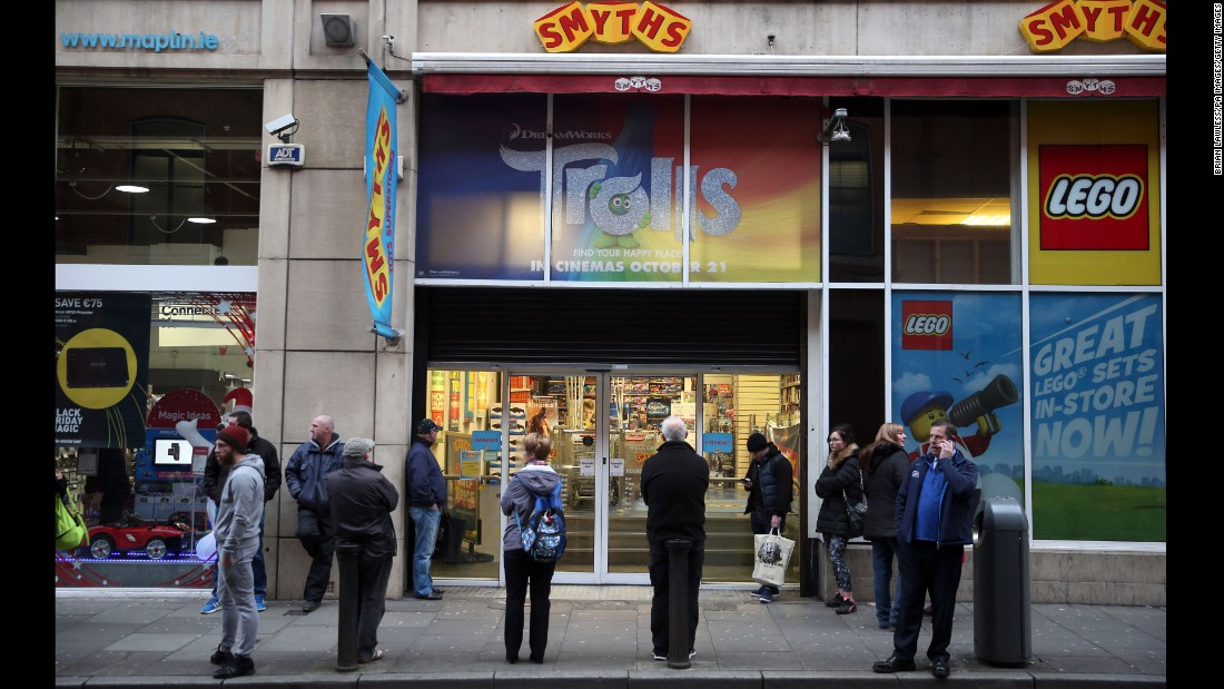 Shoppers wait outside a Smyths toy store in Dublin, Ireland.