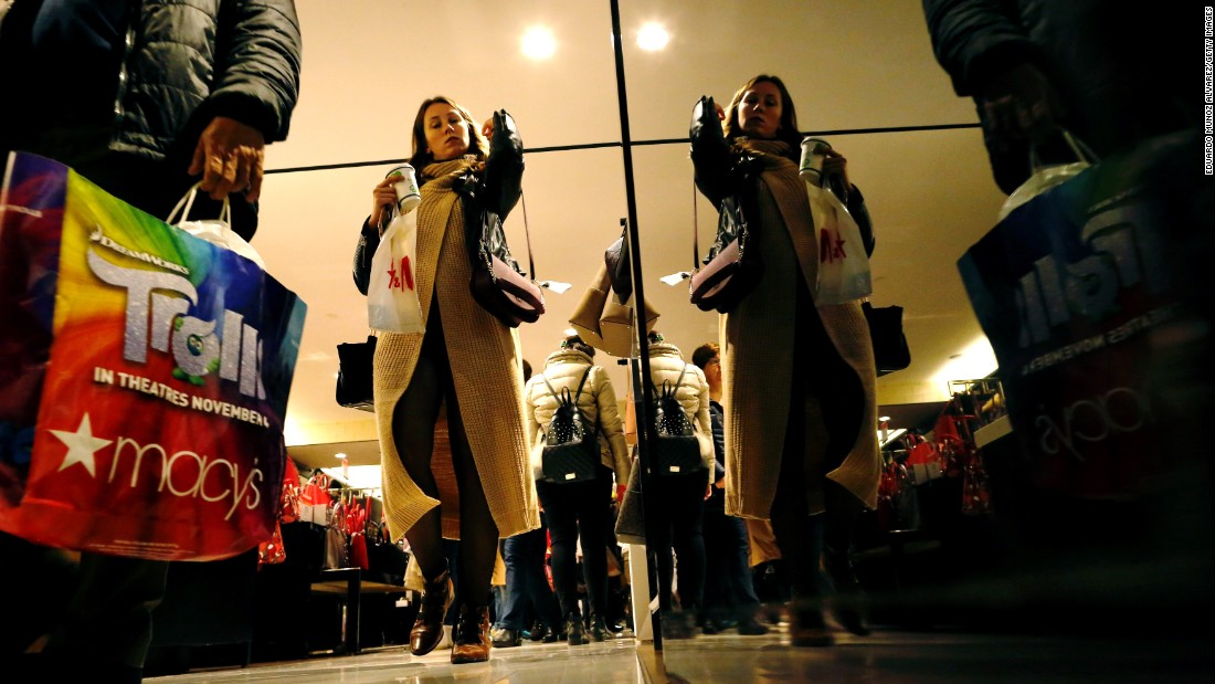 Shoppers walk inside a Macy's store in New York.