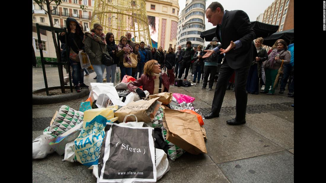 Members of the group Ecologists in Action hold a street performance in Madrid to protest the consumerist nature of Black Friday.
